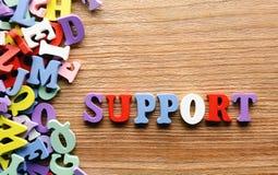 Unterstützung beschriftet Holz stockfotos