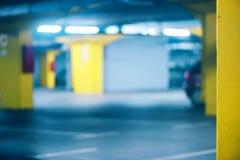 Untertagegaragen-Parkplatz, verwischen Zusammenfassung defocussed backgro Stockfotografie