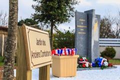 Unterzeichnen Sie die Anzeige, dass Veterane auf französisch am Eingang von a.m. im Garten arbeiten Lizenzfreie Stockbilder