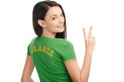Unterzeichnender Sieg des Mädchens für Brasilien. Lizenzfreie Stockfotografie