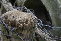 Untidy Barbed Wire On Fence Post Stock Photo