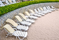 Untidy beach chairs to be cleaned up Royalty Free Stock Images