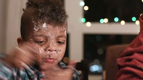 Untidy boy smeared in cake. stock footage