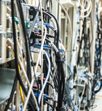 Untidy cables from the back of many servers. In the server room Stock Image