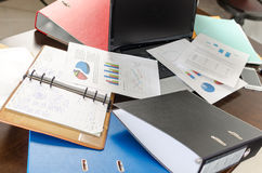 Untidy and cluttered desk Stock Photos