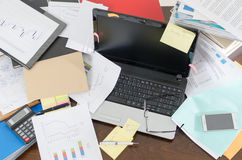 Untidy and cluttered desk Royalty Free Stock Photos