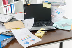 Untidy and cluttered desk Royalty Free Stock Photography