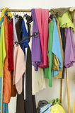 Untidy cluttered woman wardrobe with colorful clothes and access Royalty Free Stock Photos