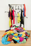 Untidy cluttered woman wardrobe with colorful clothes and accessories. Stock Image