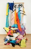 Untidy cluttered woman wardrobe with colorful clothes and accessories. Stock Photography