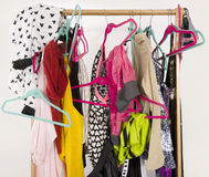 Untidy cluttered woman wardrobe with colorful clothes and accessories. Stock Photo