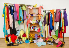 Untidy cluttered woman wardrobe with colorful clothes and accessories. Royalty Free Stock Photos