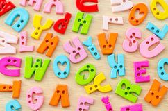 Untidy collection of plastic alphabet letters, school education stock photos