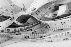 Untidy measuring tapes Stock Photography