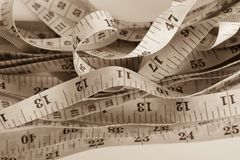 Untidy measuring tapes Stock Images