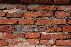 Untidy old brick wall glued by cement Stock Image