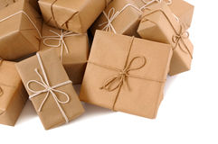 Isolated several brown paper wrapped parcels, white background Royalty Free Stock Image