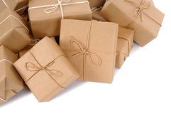 Pile of brown paper parcels or packages isolated on white Stock Image