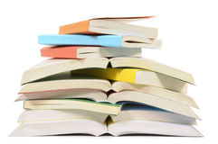 Books, untidy pile, open, isolated white background Stock Photo