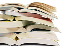 Untidy pile of open books isolated on white background Stock Photos