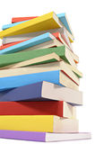 Untidy book stack heap isolated white background vertical Royalty Free Stock Photo