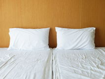 Untidy white bedding sheets and pillows stock photos