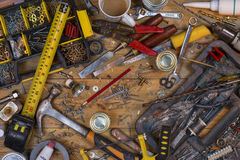 Untidy Workbench - Old Tools. Home maintenance - An untidy workbench full of dusty old tools and screws Stock Photography