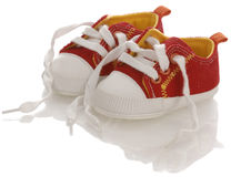 Untied baby shoes Royalty Free Stock Photo