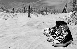 Sneakers in the sand Royalty Free Stock Photography