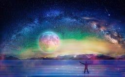 Man silhouette, meditation under stars, full moon, milky way, universe