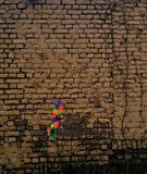 Untitled. Artificial flowers on a background of brick wall Stock Photo
