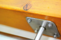 Untitled handrail. Wood handrail clodeup with metal piece and bolts Stock Photography