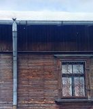 Untitled. A part of old wooden house under snow Royalty Free Stock Photos