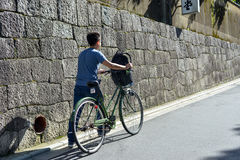 Untitled tourist rent a bicycle while travel. TOKYO, JAPAN - OCTOBER 10TH 2016: Untitled tourist rent a bicycle while travel in Tokyo, Japan Royalty Free Stock Images