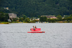 Untitled tourists family riding sightseeing boat Stock Photo