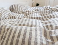 Untouched duvets and pillows on a bed. royalty free stock photo