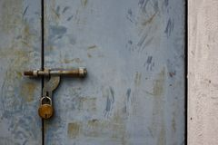 The untouched rusted locked door. Rushed locked rusted door lonely untouched risted stock photography