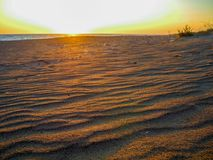 Untouched sand on the beach. Untouched sand on the deserted Kaiafas beach at sunset, Greece royalty free stock photo