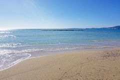 Untouched sand beach with wave residue pattern. And blue sea in Mallorca, Spain royalty free stock image
