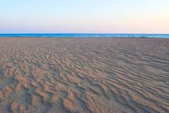 Untouched sand on the beach. Untouched sand on the deserted Kaiafas beach at sunset, Greece royalty free stock photography