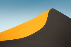 Untouched sand dune at sunset Stock Photos