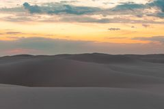 Untouched sand dunes at sunset. Untouched sand dunes at sunset - calmness and tranquility royalty free stock images