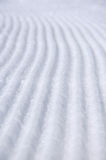 Untouched ski track. Machine groomed ski track lines close up Stock Photos