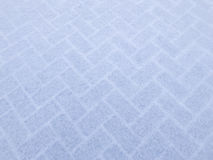 Untouched snow covered the street showing beautiful pattern back Stock Image