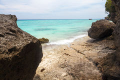 Untouched tropical beach coastline, turquoise view of the pacifi. C ocean with stone, Philippines Asia royalty free stock images