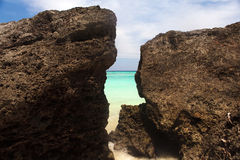 Untouched tropical beach coastline, turquoise view of the pacifi. C ocean with stone, Philippines Asia royalty free stock photo