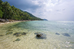 Untouched tropical beach in Thailand. Cloudy sky Stock Photo