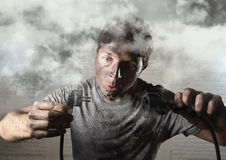 Untrained man cable suffering electrical accident with dirty burnt face in funny shock expression Stock Images