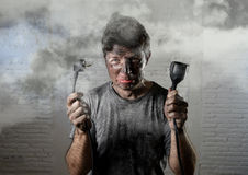 Untrained man cable suffering electrical accident with dirty burnt face in funny shock expression Royalty Free Stock Image