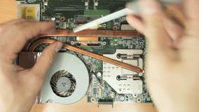 Untwisting laptop cooling system. Full HD stock video footage